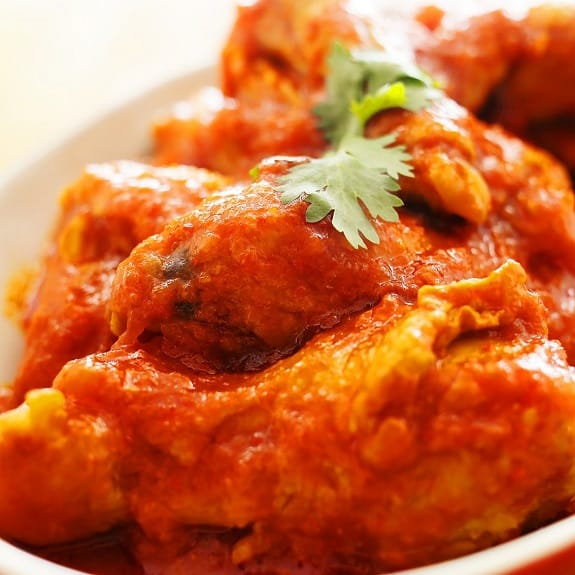 fried chicken in spicy tomato sauce