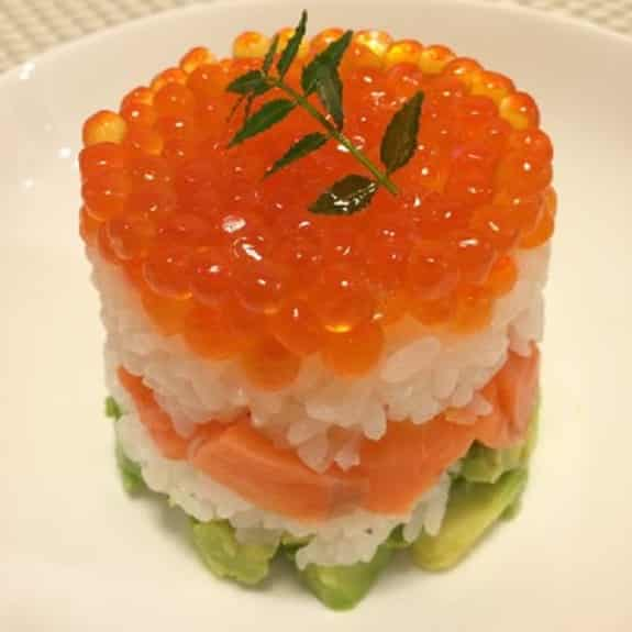 sushi with avocado and red caviar